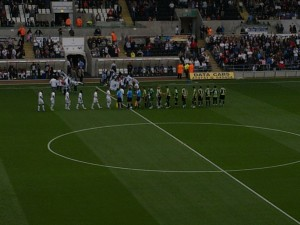 Swansea and Scunthorpe shaking hands