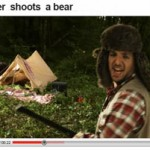 A hunter shoots a bear