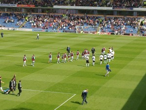 The teams are on the pitch