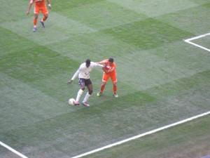 Neil Taylor holds off Adebayor